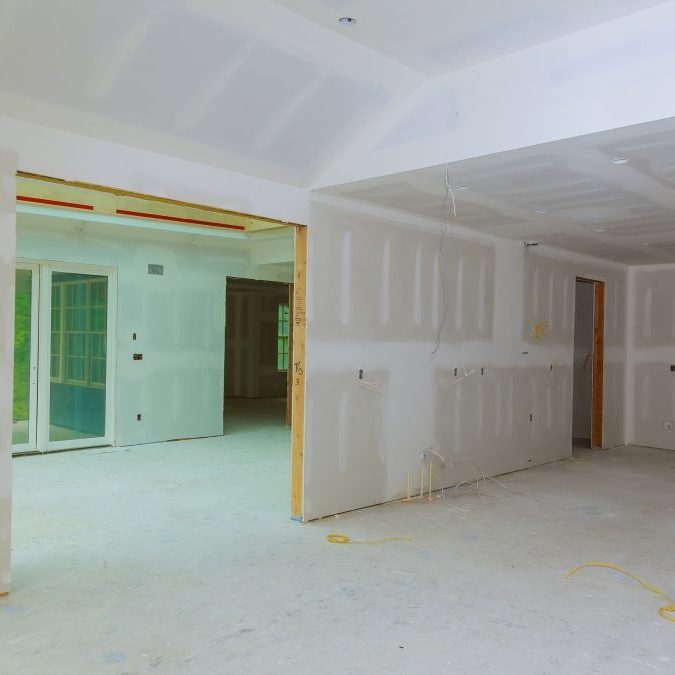 Close up on ceiling construction details with building gypsum plaster walls and ceiling of home under construction.